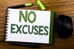 Handwriting Announcement text showing No Excuses. Business concept for Stop Ban for Excuse written on notebook book note paper on. Wooden background. Green word Stock Image