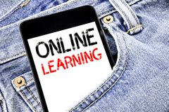 Handwriting Announcement text showing Online Learning. Business concept for E-learning Training Written phone mobile phone, cellph. One placed in man front jeans royalty free stock images