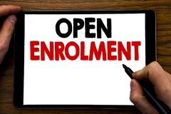 Handwriting Announcement text showing Open Enrolment. Business concept for Medicine Doctor Enroll Written on tablet laptop, wooden royalty free stock images