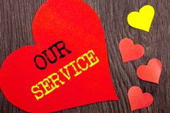Handwriting Announcement text showing Our Service. Concept meaning Customer Marketing Support Help Concept Helping Your Client wri. Tten Heart Love the wooden Stock Photos