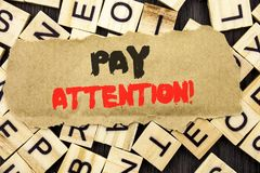 Handwriting Announcement text showing Pay Attention. Concept meaning Be Careful Beware Mindful Alarm written on tear paper note on. Handwriting Announcement text Royalty Free Stock Images