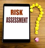 Handwriting Announcement text showing Risk Assessment. Business concept for Safety Danger Analyze Written on tablet with wooden ba. Handwriting Announcement text royalty free stock photography