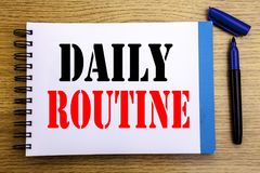 Handwriting Announcement text showing Daily Routine. Business concept for Habitual Lifestyle Written on notepad note paper backgro. Handwriting Announcement text Royalty Free Stock Image
