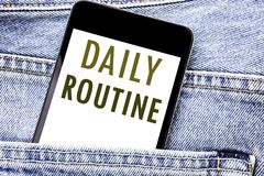 Handwriting Announcement text showing Daily Routine. Business concept for Habitual Lifestyle Written phone mobile phone, cellphone. Placed in man front jeans Royalty Free Stock Images
