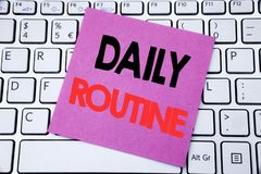 Handwriting Announcement text showing Daily Routine. Business concept for Habitual Lifestyle written on sticky note paper on the w. Handwriting Announcement text Royalty Free Stock Photography