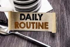 Handwriting Announcement text showing Daily Routine. Business concept for Habitual Lifestyle written on sticky note paper on the w. Handwriting Announcement text Royalty Free Stock Image