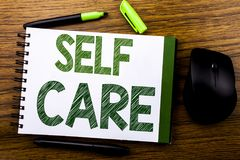 Handwriting Announcement text showing Self Care. Business concept for Taking caring for own Health written on notebook book note p. Aper on wooden background Royalty Free Stock Image