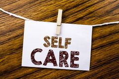 Handwriting Announcement text showing Self Care. Business concept for Taking caring for own Health written on sticky note paper on. Wooden background Royalty Free Stock Image