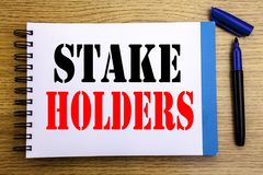 Handwriting Announcement text showing Stake Holders. Business concept for Stakeholder Engagement Written on notepad note paper bac. Handwriting Announcement text stock photo