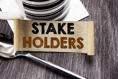 Handwriting Announcement text showing Stake Holders. Business concept for Stakeholder Engagement written on sticky note paper on t. Handwriting Announcement text stock images