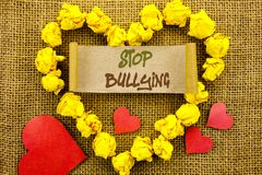 Handwriting Announcement text showing Stop Bullying. Concept meaning Awareness Problem About Violence Abuse Bully Problem written. Sticky Note Paper With Heart Stock Image