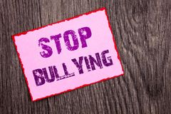 Handwriting Announcement text showing Stop Bullying. Conceptual photo Awareness Problem About Violence Abuse Bully Problem written. Pink Sticky Note Paper the Stock Images