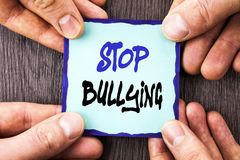 Handwriting Announcement text showing Stop Bullying. Conceptual photo Awareness Problem About Violence Abuse Bully Problem written. Sticky Note Paper Holding Royalty Free Stock Photo