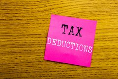 Handwriting Announcement text showing Tax Deductions. Business concept for Finance Incoming Tax Money Deduction written on sticky. Note empty paper, background Stock Images