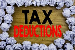 Handwriting Announcement text showing Tax Deductions. Business concept for Finance Incoming Tax Money Deduction written on wooden stock photography