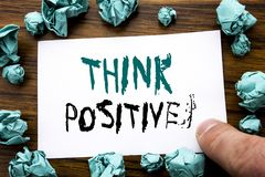Handwriting Announcement text showing Think Positive. Business concept for Positivity Attitude Written on sticky note paper, woode. N background folded yellow Stock Photos