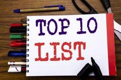 Handwriting Announcement text showing Top 10 Ten List. Business concept for Success ten list Written on notebook, wooden backgroun. D office equipment like pens Stock Photography