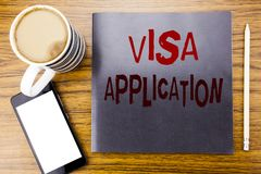 Handwriting Announcement text showing Visa Application. Business concept for Passport Apply Written on notepad note paper, wooden. Wood background coffee pen Royalty Free Stock Photography