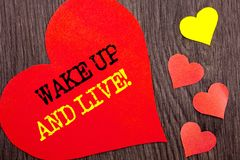 Handwriting Announcement text showing Wake Up And Live. Concept meaning Motivational Success Dream Live Life Challenge written on. Handwriting Announcement text Royalty Free Stock Photography