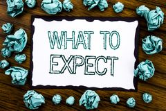 Handwriting Announcement text showing What To Expect. Business concept for Achieve Expectation Written on sticky note paper, woode. N background folded blue Royalty Free Stock Images