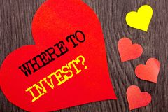 Handwriting Announcement text showing Where To Invest Question. Concept meaning Financial Income Investing Plan Advice Wealth writ. Ten Heart Love the wooden Royalty Free Stock Photo