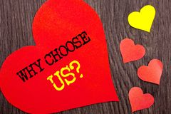 Handwriting Announcement text showing Why Choose Us Question. Concept meaning Reason Of Choice Customer Satisfaction Advantage wri. Tten Heart Love the wooden Royalty Free Stock Photography