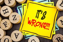 Handwriting Announcement text showing It Is Wrong. Business photo showcasing Correct Right Decision To Make Or Mistake Advice writ. Ten  wooden abckground with Stock Images