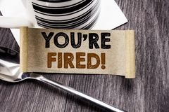 Handwriting Announcement text showing You Are Fired. Business concept for Unemployed or Discharge written on sticky note paper on. Wooden wood background. With Stock Images