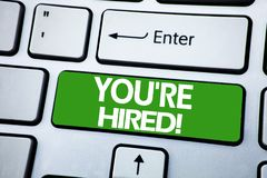 Handwriting Announcement text showing You Are Hired. Business concept for Hiring Employee Worker written on blue key on the keybor. Handwriting Announcement text stock photos