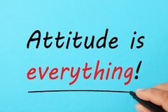 Attitude Is Everything. Handwriting Attitude is everything text on a blue background. Business concept stock photography