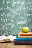 Handwriting blackboard with stack of books Royalty Free Stock Image