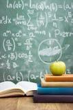 Handwriting blackboard z stertą książki obraz royalty free