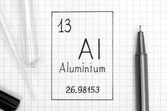 Handwriting chemical element Aluminium Al with black pen, test tube and pipette. The Periodic table of elements. Handwriting chemical element Aluminium Al with stock image