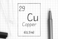 Handwriting chemical element Copper Cu with black pen, test tube and pipette. The Periodic table of elements. Handwriting chemical element Copper Cu with black royalty free stock photos