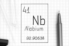 Handwriting chemical element Niobium Nb with black pen, test tube and pipette. The Periodic table of elements. Handwriting chemical element Niobium Nb with black stock image