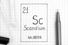 Handwriting chemical element Scandium Sc with black pen, test tube and pipette. The Periodic table of elements. Handwriting chemical element Scandium Sc with stock images