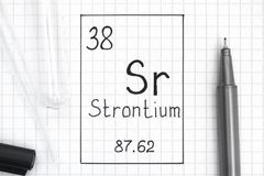 Handwriting chemical element Strontium Sr with black pen, test tube and pipette. The Periodic table of elements. Handwriting chemical element Strontium Sr with royalty free stock image