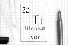 Handwriting chemical element Titanium Ti with black pen, test tube and pipette. The Periodic table of elements. Handwriting chemical element Titanium Ti with royalty free stock images