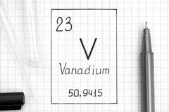 Handwriting chemical element Vanadium V with black pen, test tube and pipette. The Periodic table of elements. Handwriting chemical element Vanadium V with black stock photo