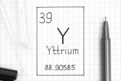 Handwriting chemical element Yttrium Y with black pen, test tube and pipette. The Periodic table of elements. Handwriting chemical element Yttrium Y with black stock photography