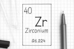Handwriting chemical element Zirconium Zr with black pen, test tube and pipette. The Periodic table of elements. Handwriting chemical element Zirconium Zr with stock photo