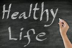 Handwriting healthy concept on blackboard Royalty Free Stock Image