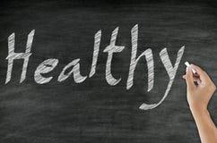 Handwriting healthy concept on blackboard Stock Photography