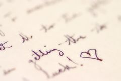Handwriting with a heart. Letter with a heart at the end Royalty Free Stock Photography