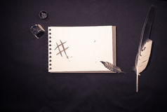 Handwriting with ink and feather and digital writing sign   hashtag. Fusion of traditional manual hard print copy handwriting with ink and feather and digital Stock Photo