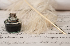 Handwriting,ink and quill pen. Vintage composition of handwriting, quill pen and ink. Selective focus on ink and pen. Text is from Shakespeare's Sonnet 18 Royalty Free Stock Image