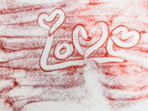 Handwriting Love on red glitter Royalty Free Stock Images