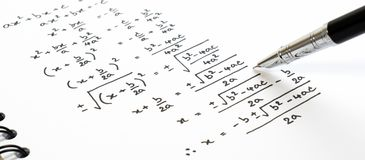 Handwriting of mathematics quadratic equation formula on examination, practice, quiz or test in math class. Solving exponential equations background concept royalty free stock photos