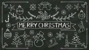Handwriting 'Merry Christmas' at chalkboard. with various graphic. Handwriting 'Merry Christmas' at chalkboard