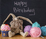 Handwriting message on chalk board with felt doll Stock Image